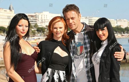 "Italian actor, producer, director, Rocco Siffredi poses for photographers with the new Dorcel Girls, Anna Polina, left, Tara White, second from left and Jade Laroche during the MIPTV (International Television Programme Market), in Cannes, southern France.They celebrate the 5th anniversary of the XXX tv channel ""Dorcel TV"