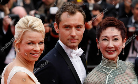 Nansun Shi, Linn Ullmann, Jude Law Members of the Jury Linn Ullmann, left, Jude Law, centre, and Nansun Shi pose on the red carpet for the screening of Pirates of the Caribbean: On Stranger Tides, at the 64th international film festival, in Cannes, southern France
