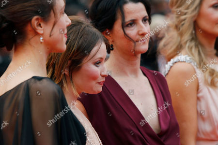 Emily Browning, Julia Leigh, Rachael Blake, guest From left, a unidentified guest, actress Emily Browning, director Julia Leigh and actress Rachael Blake arrive for the screening of Sleeping Beauty at the 64th international film festival, in Cannes, southern France