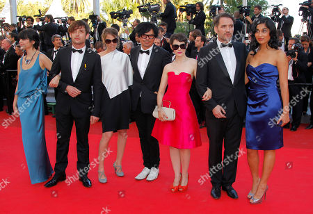 Stock Photo of Gabriella Arancibia, Cristian Jimenez, Nathalia Galgani, Diego Noguera Actress Gabriela Arancibia, right, director Cristian Jimenez, second right, actress Nathalia Galgani, third right, and Diego Noguera, second left, arrive for the screening of The Artist at the 64th international film festival, in Cannes, southern France