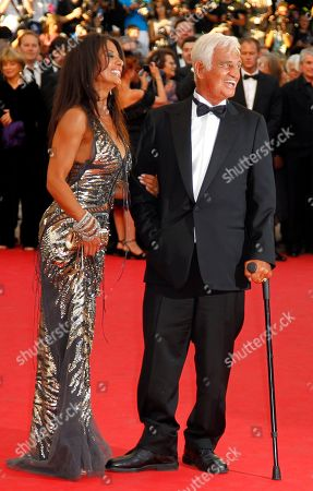 Jean Paul Belmondo, Barbara Gandolfi Actor Jean-Paul Belmondo, right, arrives to be honoured for his career in the film industry with Barbara Gandolfi during the 64th international film festival, in Cannes, southern France