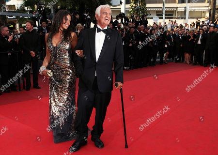 Jean-Paul Belmondo, Barbara Gandolfi Actor Jean-Paul Belmondo, right, arrives to be honoured for his career in the film industry with Barbara Gandolfi during the 64th international film festival, in Cannes, southern France