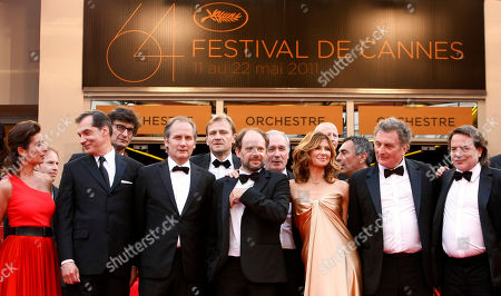 Samuel Labarthe, Hippolyte Girardot, Denis Podalydes, Florence Pernel, Patrick Rotman, Xavier Durringer From second left, actor Samuel Labarthe, Hippolyte Girardot, Denis Podalydes, Florence Pernel, screenwriter Patrick Rotman and director Xavier Durringer arrive for the screening of The Conquest at the 64th international film festival, in Cannes, southern France