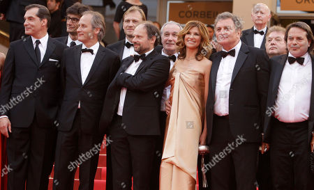 Samuel Labarthe, Hippolyte Girardot, Denis Podalydes, Florence Pernel, Patrick Rotman, Xavier Durringer First row from left, actors Samuel Labarthe, Hippolyte Girardot, Denis Podalydes, Florence Pernel, screenwriter Patrick Rotman and director Xavier Durringer pose on the red carpet for the screening of The Conquest at the 64th international film festival, in Cannes, southern France