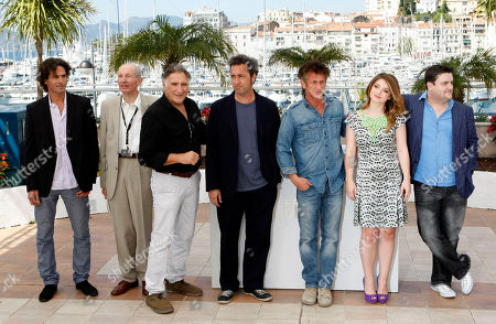 Liron Levo, Heinz Lieven, Judd Hirsch, Paolo Sorrentino, Sean Penn, Eve Hewson, Simon Delaney Director Paolo Sorrentino, center, poses with actors, from left, Liron Levo, Heinz Lieven, Judd Hirsch, Sean Penn, Eve Hewson and Simon Delaney during a photo call for This Must Be The Place, at the 64th international film festival, in Cannes, southern France