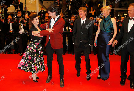 From left, director Lynne Ramsay, Ezra Miller, Rory Stewart Kinnear, Tilda Swinton and John C. Reilly arrive for the screening of We Need to Talk About Kevin at the 64th international film festival, in Cannes, southern France