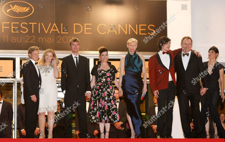 From second right, actors John C. Reilly, Ezra Miller, Tilda Swinton, director Lynne Ramsay and actor Rory Stewart Kinnear stand at the top of the steps as they arrive for the screening of We Need to Talk About Kevin at the 64th international film festival, in Cannes, southern France