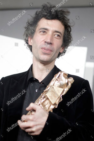Eric Elmosnino French actor Eric Elmosnino holds a Cesar for the best actor during the 36th French Cesar Awards Ceremony in Paris
