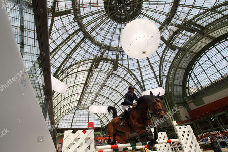 Stock Picture of Tobias Meyer German Tobias Meyer jumps with Aluta, during Paris Hermes CSI U25-A jumping competition at the Grand Palais in Paris