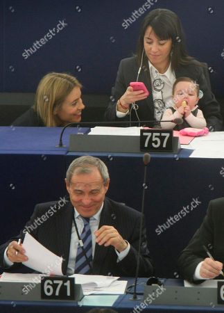 Licia Ronzulli Member of European Parliament Licia Ronzulli of Italy, top right, holds her baby as she attends the session of the European Parliament in Strasbourg eastern France, on International Women's Day