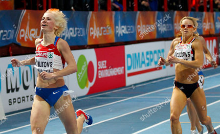 Russia's Yevgeniya Zinurova, left, crosses the finish line ahead of Britain's Jenny Meadows to win the gold medal in the final of the Women's 800m at the European Indoor Athletics Championships in Paris