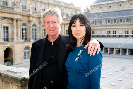 Linh Dan Pham, Regis Wargnier French actress Linh Dan Pham, left, flanked with French Director Regis Wargnier, poses with the medal after she was awarded the Knight of Arts and Letters by French Culture Minister Frederic Mitterrand during a ceremony at the Culture Ministry in Paris