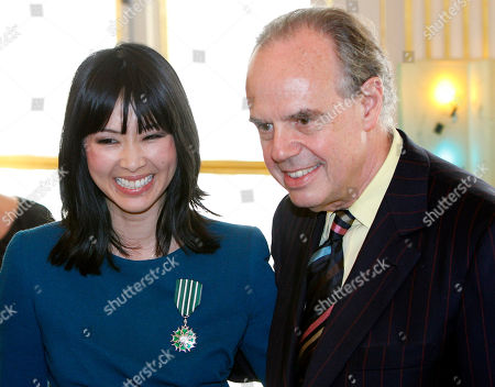 Linh Dan Pham French actress Linh Dan Pham, poses with the medal after she was awarded the Knight of Arts and Letters by French Culture Minister Frederic Mitterrand, right, during a ceremony at the Culture Ministry in Paris