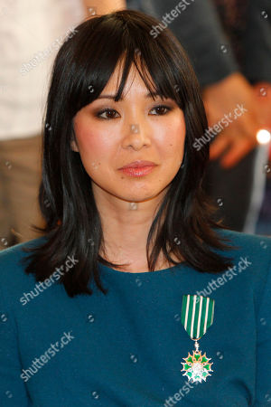 Linh Dan Pham French actress Linh Dan Pham, poses with the medal after she was awarded the Knight of Arts and Letters by French Culture Minister Frederic Mitterrand during a ceremony at the Culture Ministry in Paris