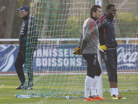 Steve Mandanda, Cedric Carrasso, Laurent Blanc France's goalkeeper Steve Mandanda, right, and Cedric Carrasso, center, take a break while coach Laurent Blanc waks behind the goal during a training session at Clairefontaine training center, in Clairefontaine, west of Paris, . France play a Euro 2012 qualifier against Luxembourg on March 25 and a friendly against Croatia four days later