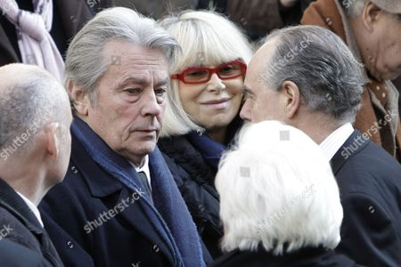 Alain Delon, Mireille Darc, Frederic Mitterand French actor Alain Delon, left, French actress Mireille Darc, center, and French Culture Minister Frederic Mitterand, partially visible at right, are seen after the funeral ceremony of French actress Annie Girardot held at the Saint Roch church in Paris, . Annie Girardot, the perky, gravelly-voiced actress who became one of France's most enduring and acclaimed modern stars, died on Monday. She was 79