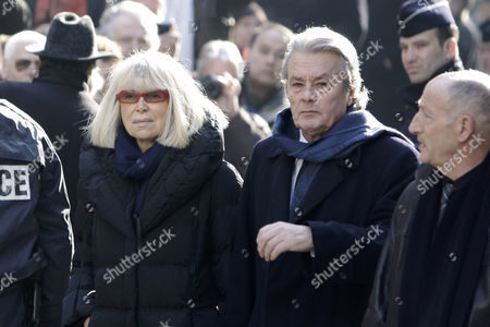 Stock Photo of Alain Delon, Mireille Darc French actor Alain Delon, right, and French actress Mireille Darc arrive at the funeral ceremony of French actress Annie Girardot held at the Saint Roch church in Paris, . Annie Girardot, the perky, gravelly-voiced actress who became one of France's most enduring and acclaimed modern stars, died on Monday. She was 79