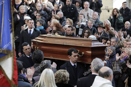 Pallbearers carry the coffin of French actress Annie Girardot following her funeral ceremony held at the Saint Roch church in Paris, . Annie Girardot, the gravelly-voiced actress who became one of France's most enduring and acclaimed modern stars, died on Monday. She was 79