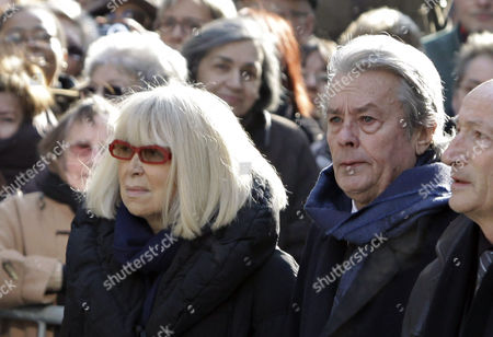 Alain Delon, Mireille Darc French actor Alain Delon, right, and French actress Mireille Darc arrive at the funeral ceremony of French actress Annie Girardot held at the Saint Roch church in Paris, . Annie Girardot, the gravelly-voiced actress who became one of France's most enduring and acclaimed modern stars, died on Monday. She was 79