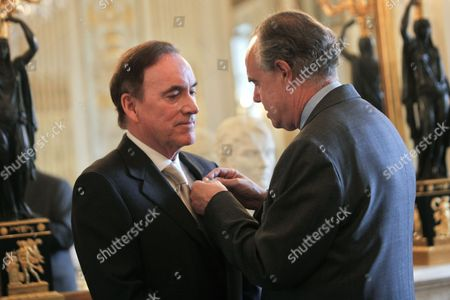 Richard J. Fox, Frederic Mitterand French Culture Minister Frederic Mitterrand, right, awards US Warner Bros' executive President Richard J. Fox, left, to the Officer of the Order of Arts and Letters, in Paris