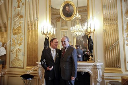 Richard J. Fox, Frederic Mitterand US Warner Bros' executive President Richard J. Fox, left, speaks with French Culture Minister Frederic Mitterrand, right, after being awarded Officer of the Order of Arts and Letters, in Paris