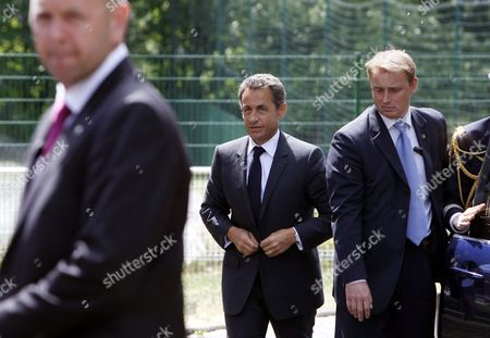 Nicolas Sarkozy French President Nicolas Sarkozy, center, arrives at a meeting on employment in Nancy, eastern France, .The Bild newspaper on Tuesday quoted Sarkozy's father Pal Sarkozy as confirming that his son and wife Carla Bruni-Sarkozy are expecting their first child together
