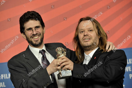 Stock Image of Joshua Marston, Andamion Murataj U.S. director Joshua Marston, left, and Albanian scriptwriter Andamion Murataj, right, present the Silver Bear Award for the Best Script for the film 'The Forgiveness of Blood during a news conference at the International Film Festival Berlinale in Berlin, Germany