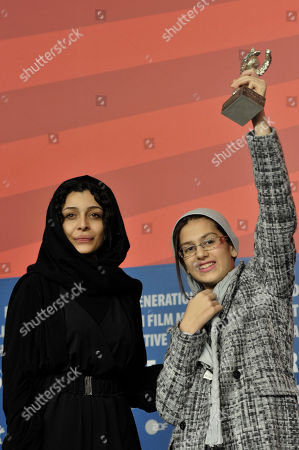 Leila Hatami, Sarina Farhadi Iranian actress, Leila Hatami, left, and Iranian actress Sarina Farhadi, right, present the Silver Bear Awards for the best actress-ensemble at the film 'Nader And Simin A Separation' during a news conference at the International Film Festival Berlinale in Berlin, Germany