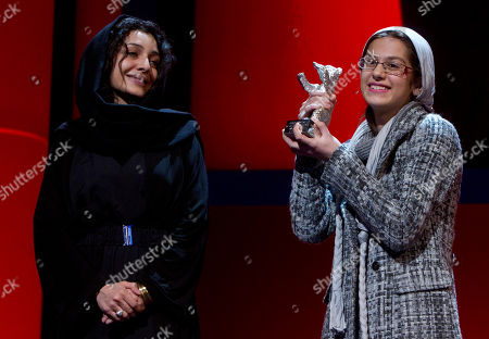 Sarina Farhadi, Leila Hatami Iranian actress Leila Hatami, left, and Iranian actress Sarina Farhadi, right, react as they receive the Silver Bear Award for the best actress-ensemble for the movie 'Nader And Simin A Separation' during the awarding ceremony at the International Film Festival Berlinale in Berlin, Germany