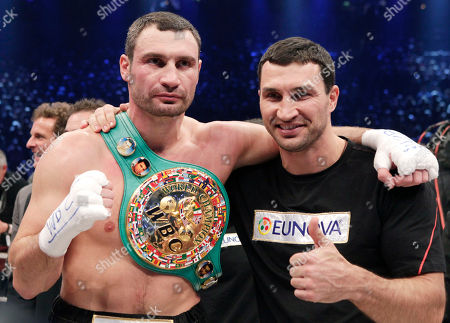 Vitali Klitschko, Wladimir Klitschko Champion Vitali Klitschko, left, of the Ukraine and his brother Wladimir pose for photo after defeating challenger Odlanier Solis of Cuba in the WBC heavyweight title bout to retain his championship in Cologne, Germany