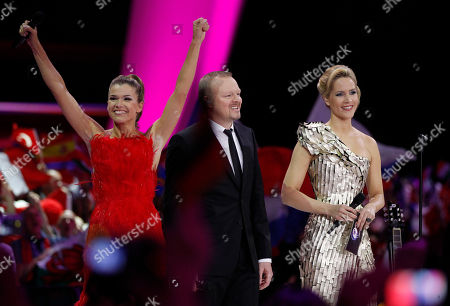 Presenters Anke Engelke, Stefan Raab and Judith Rakers, from left, welcome the audience during the final of the Eurovision Song Contest 2011 in Duesseldorf, Germany