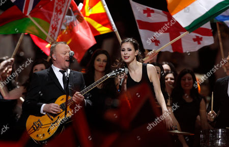 Germany's Lena, who won last year's competition, and presenter Stefan Raab perform last year's winning the song during the final of the Eurovision Song Contest 2011 in Duesseldorf, Germany