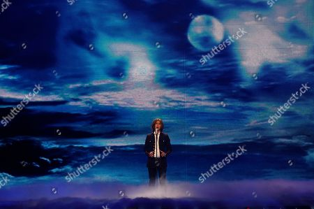 Stock Image of France's Amaury Vassili sings his song 'Sognu' during the final of the Eurovision Song Contest 2011 in Duesseldorf, Germany