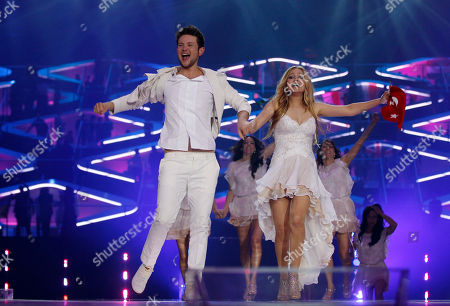 Winners Ell/Nikki, Nigar Jamal and Eldar Gasimov, from Azerbaijan celebrate winning the final of the Eurovision Song Contest 2011 with their song 'Running Scared' in Duesseldorf, Germany