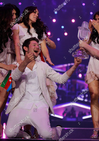 Winners Ell/Nikki, Eldar Gasimov, from Azerbaijan celebrate winning the final of the Eurovision Song Contest 2011 with their song 'Running Scared' in Duesseldorf, Germany