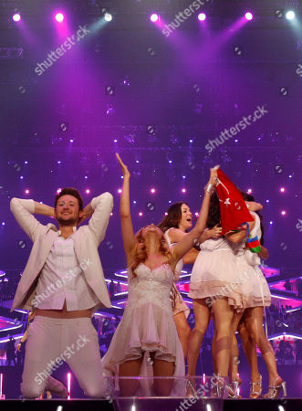 Winners Ell/Nikki, Nigar Jamal, second left, and Eldar Gasimov, left, from Azerbaijan celebrate winning the final of the Eurovision Song Contest 2011 with their song 'Running Scared' in Duesseldorf, Germany