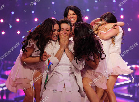 Stock Picture of Winners Ell/Nikki, Nigar Jamal and Eldar Gasimov, from Azerbaijan celebrate winning the final of the Eurovision Song Contest 2011 with their song 'Running Scared' in Duesseldorf, Germany