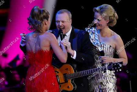 Presenters Anke Engelke, Stefan Raab and Judith Rakers, from left, sing last year's winning song during the final of the Eurovision Song Contest 2011 in Duesseldorf, Germany