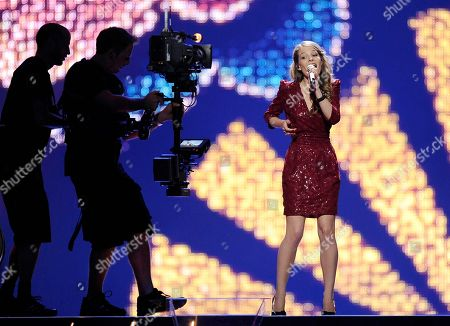 Anna Rossinelli Anna Rossinelli performs for Switzerland during a dress rehearsal prior to the first semifinal of the Eurovision Song Contest (ESC) in Duesseldorf, western Germany, . The final of the ESC 2011 is to take place in Duesseldorf on Saturday, May 14