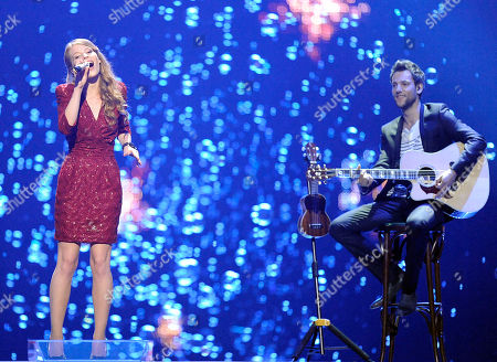 Anna Rossinelli Anna Rossinelli, left, of Switzerland performs the song 'In Love for a While' during the first semifinal of the Eurovision Song Contest (ESC) in Duesseldorf, Germany, . The final of the ESC will be held on Saturday