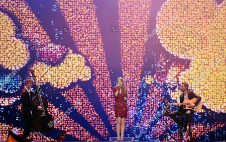 Anna Rossinelli Anna Rossinelli, center, of Switzerland performs the song 'In Love for a While' during the first semifinal of the Eurovision Song Contest (ESC) in Duesseldorf, Germany, . The final of the ESC will be held on Saturday