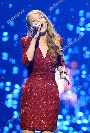Anna Rossinelli Anna Rossinelli of Switzerland performs the song 'In Love for a While' during the first semifinal of the Eurovision Song Contest (ESC) in Duesseldorf, Germany, . The final of the ESC will be held on Saturday