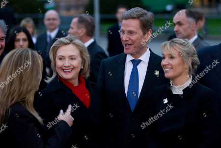 Trinidad Jim?nez, Hillary Rodham Clinton, Guido Westerwelle, Lene Espersen Spain's Foreign Minister Trinidad Jiminez, United States Secretary of State Hillary Rodham Clinton, German Foreign Minister Guido Westerwelle and Denmark's Foreign Minister Lene Espersen, from left, talk to each other after a group photo with the other NATO foreign ministers in front of the Brandenburg Gate prior to a dinner during their informal meeting in Berlin