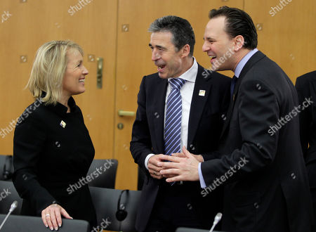 NATO Secretary General Anders Fogh Rasmussen, center, shares light moment with Denmark's Foreign Minister Lene Espersen and Greece's Foreign Minister Dimitris P. Droutsas, right, prior to a session of the informal meeting of the NATO foreign ministers in the Foreign Ministry in Berlin