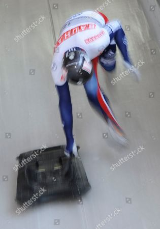 Stock Photo of Kristian Bromley Kristian Bromley from Great Britian starts his third run in the men's Skeleton World Championships race in Koenigssee, southern Germany, on