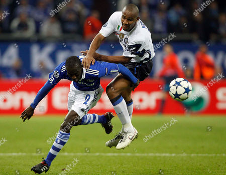 Hans Sarpei, Maicon Schalke's Hans Sarpei of Ghana, left, and Milan's Maicon challenge for the ball during the second leg quarterfinal Champions League soccer match between Schalke 04 and Inter Milan in Gelsenkirchen, Germany