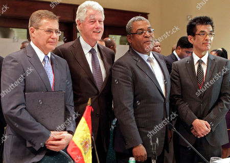 Arturo Reig Tapia, Bill Clinton, Jean-Max Bellerive, Kentaro Minami From left to right: Spain's Arturo Reig Tapia, special ambassador for the reconstruction of Haiti, Bill Clinton, former U.S. president and U.N. special envoy to Haiti, Jean-Max Bellerive, Haiti's prime minister and Kentaro Minami, Japanese ambassador to Haiti, pose for a photo at the end of their interim reconstruction commission meeting in Port-au-Prince, Haiti
