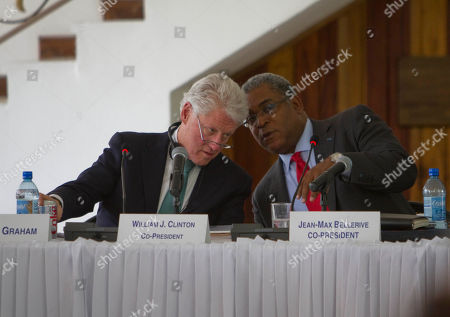 Stock Photo of Bill Clinton, Jean-Max Bellerive Former U.S. President and UN special envoy to Haiti, Bill Clinton, left, speaks to Haiti's Prime Minister Jean-Max Bellerive during a Interim Haiti Reconstruction Commission meeting in Port-au-Prince, Haiti