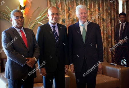 Stock Image of Bill Clinton, Jean-Max Bellerive, Michel Martelly Former President and special U.N. envoy to Haiti Bill Clinton, third from left, poses for photographers with Haiti's Prime Minister Jean-Max Bellerive, left, and Haiti's presidential candidate Michel Martelly in Port-au-Prince, Haiti