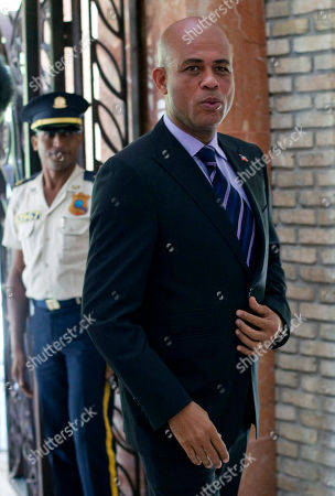 Michel Martelly Haiti's presidential candidate Michel Martelly arrives for a meeting with former President and special U.N. envoy to Haiti Bill Clinton and Haiti's Prime Minister Jean-Max Bellerive at the Karibe hotel in Port-au-Prince, Haiti